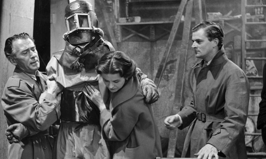 Quatermass (Reginald Tate, left) helps the dying astronaut Carroon in The Quatermass Experiment. Pho