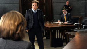 """The Seven Day Rule""--When Clarke (Nathan Lane, right) decides that the Will and Diane are hurting his efforts to erase the firm√¢¬?¬?s debts, he and Louis Canning (Michael J Fox, center), the firm√¢¬?¬?s new creditor, take them to court to argue against an extension of their deadline to pay off the debts, on THE GOOD WIFE, Sunday Jan 27 (9:00-10:00 PM, ET/PT) on the CBS Television Network. Photo: Jeff Neira/CBS √?¬©2012 CBS Broadcasting, Inc. All Rights Reserved"